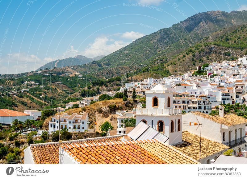Picturesque town of Frigiliana located in mountainous region of Malaga, Andalusia, Spain frigiliana andalusia spain street picturesque washed white houses
