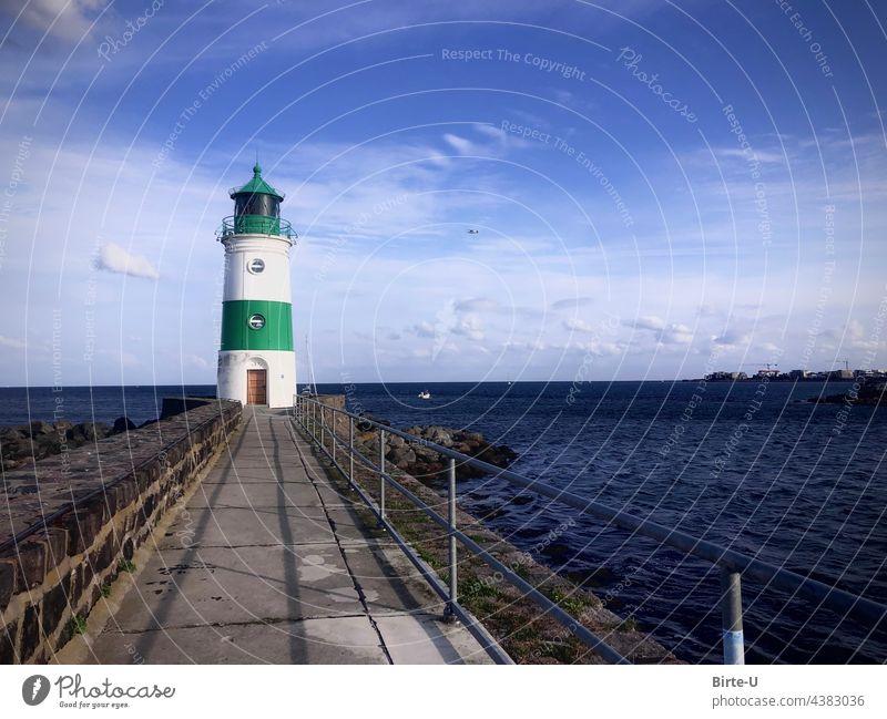 Schleimünde Lighthouse mucous color picture Ocean coast Clouds Nature bllau Horizon Water Blue Deserted Beautiful weather Waves Mole Baltic Sea vacation