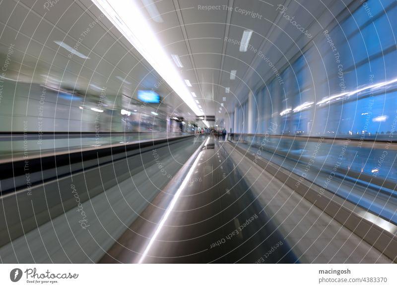 Passenger conveyor belt at the airport Moving pavement Airport Escalator Architecture Neon light Interior shot Modern Long exposure Movement Light Speed
