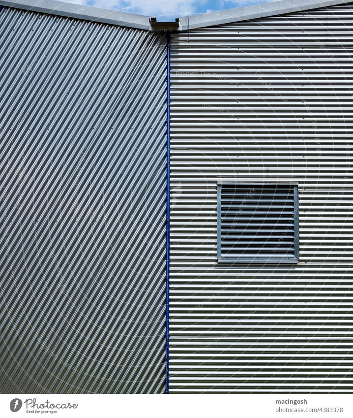 Industrial facade with corrugated sheet metal Industry Metal Deserted Industrial zone Facade Exterior shot Building Industrial plant Factory Architecture