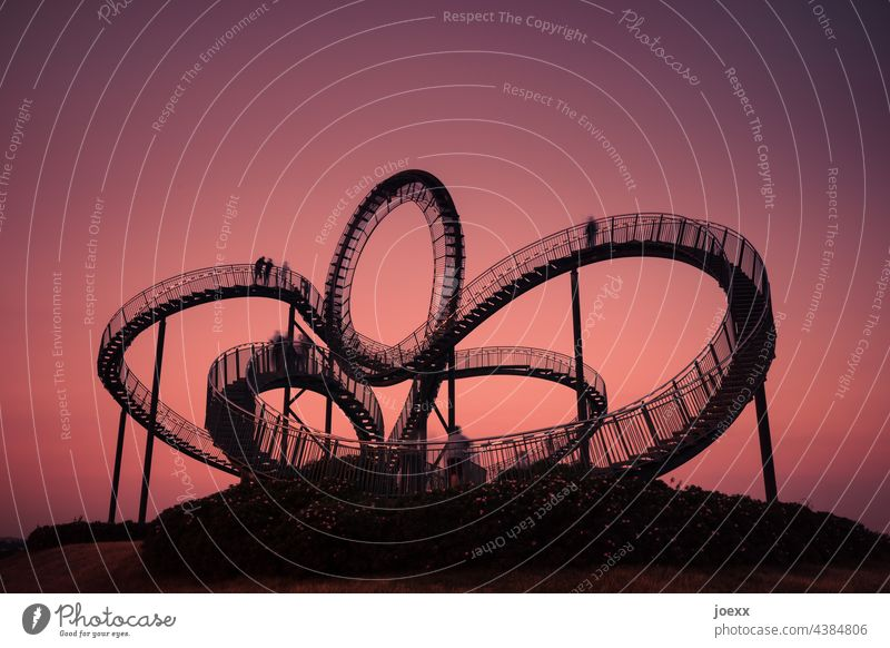 Curved steel staircase in front of red evening sky, long exposure Tiger and Turtle Work of art Stairs Steel Metal Arch curvy Round evening mood Construction