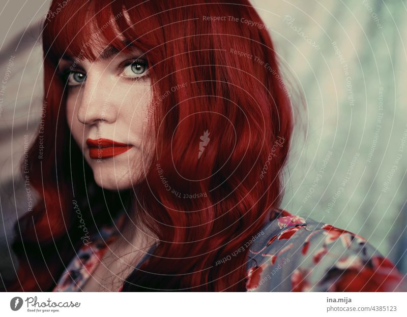 Portrait of a redheaded woman with red lips Red-haired red hair Woman portrait Face pretty Fashion Style Charming Beauty Photography Attractive Model Modern