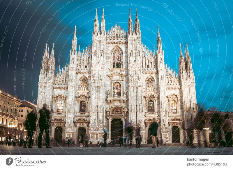 Milan Cathedral , Duomo di Milano, is the gothic cathedral church of Milan, Italy. Shot in the dusk from the square ful of people milan italy landmark duomo