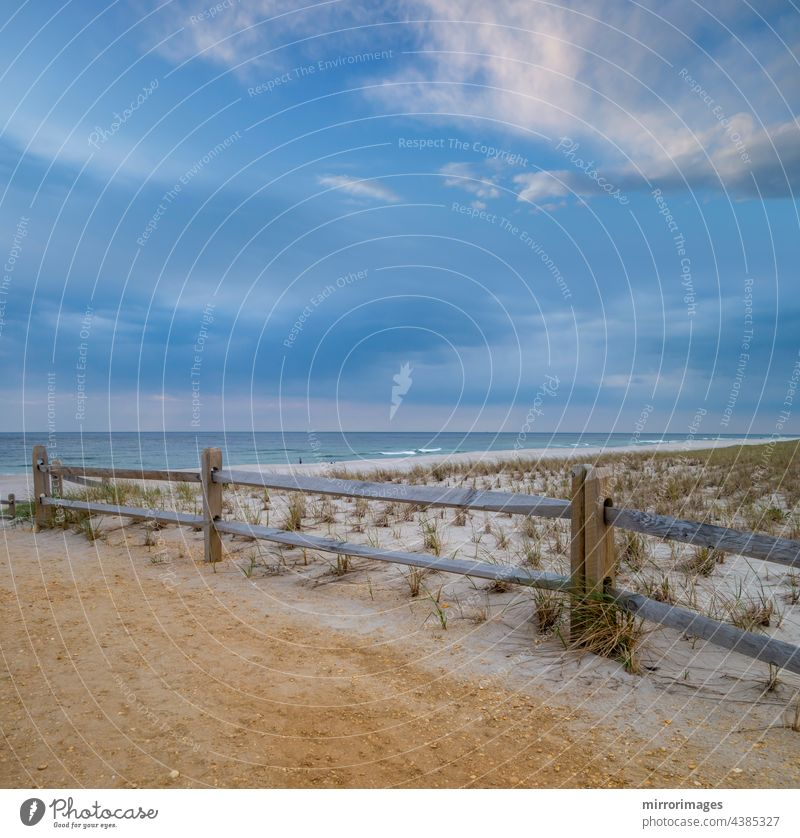 beach summer sand and wood fenced sand dunes with white clouds, blue sky and ocean waves background beaches beautiful coast coastline day ecuador environment