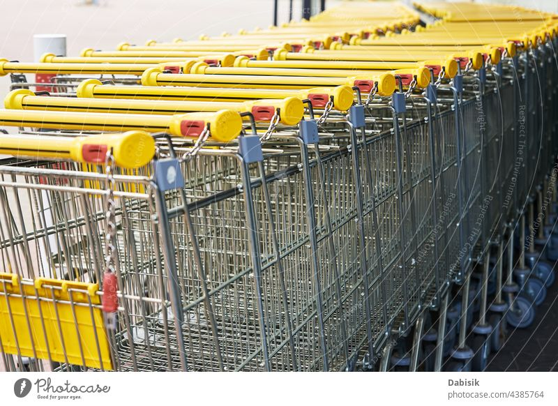 Row of empty shopping cart near a shop, close up supermarket basket retail store buy business background trolley grocery metal sale consumer purchase customer