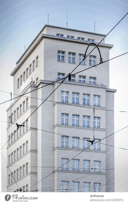 Power line in front of high-rise building at Albertplatz in Dresden High-rise Architecture Prefab construction Facade Window GDR Manmade structures Gloomy