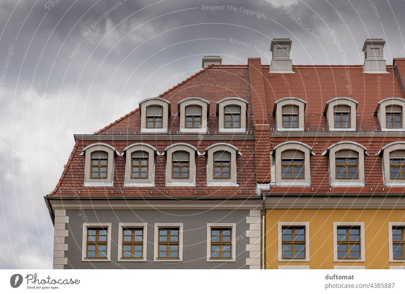 Colorful facade of an old building with skylights and tile attic Old building Attic story Roof House (Residential Structure) brick pediment Architecture