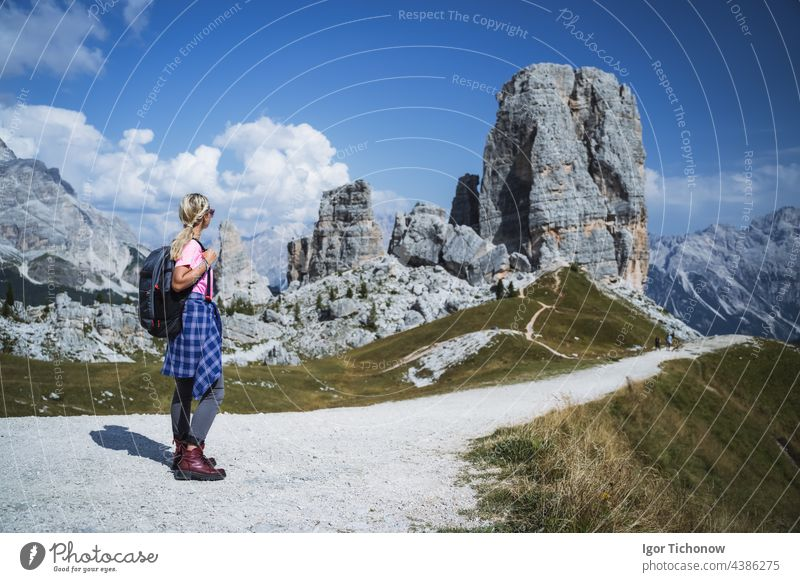 Hiker with backpack explore Cinque Torri mountains in Dolomites, Italy italy dolomites hiker cinque girl outdoor landscape travel sport hiking nature alps path