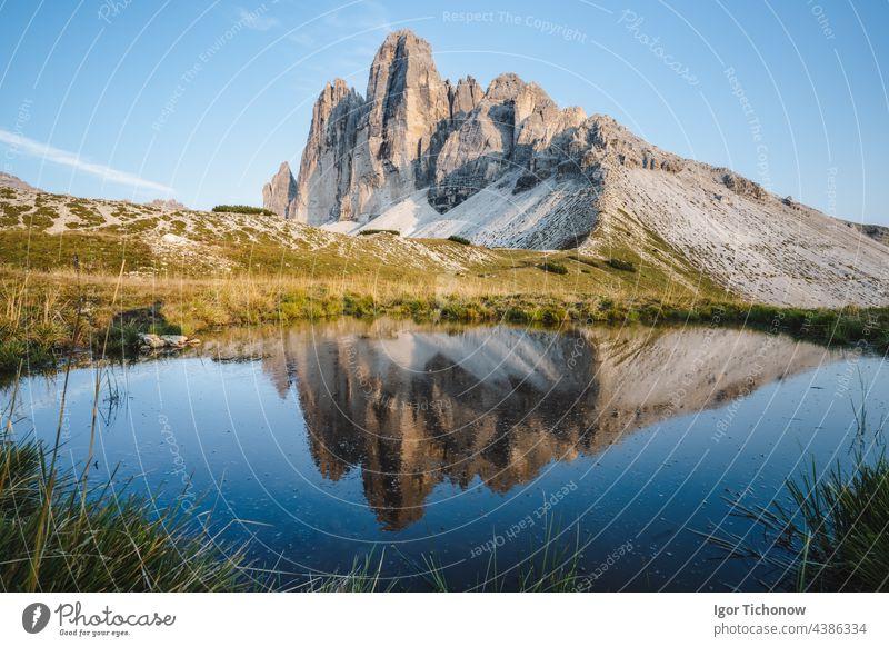 Famous Tre Cime di Lavaredo reflected in small pond, Dolomites Alps Mountains, Italy, Europe. Tre Cime mount in Dolomites dolomites tre cime alps mountains lake