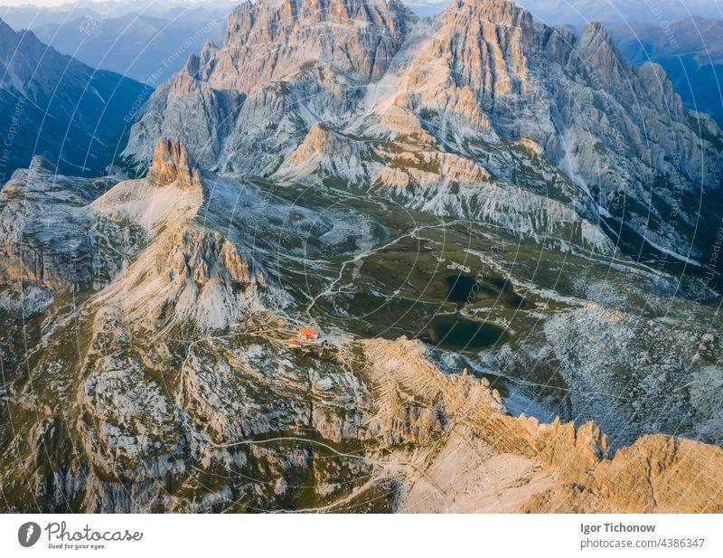 Aerial view of Dreizinnenhuette - Rifugio Antonio Locatelli close to Tre Cime di Lavaredo, Dolomites, South Tyrol, Italy famous aerial nature mountain sunset