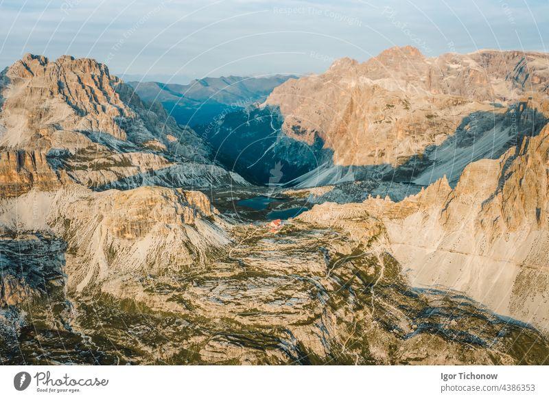 Incredible nature aerial landscape around famous Tre Cime di Lavaredo. Rifugio Antonio Locatelli alpine hut popular travel destination in the Dolomites, Italy