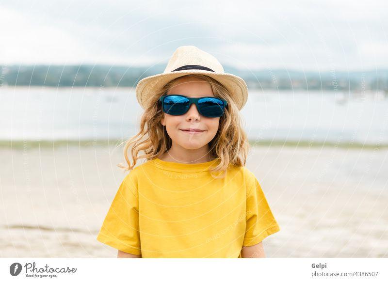 Happy child having fun on summer vacation sun blue holiday beach beautiful sea travel dream enjoy freedom imagination kid relax happiness yellow person
