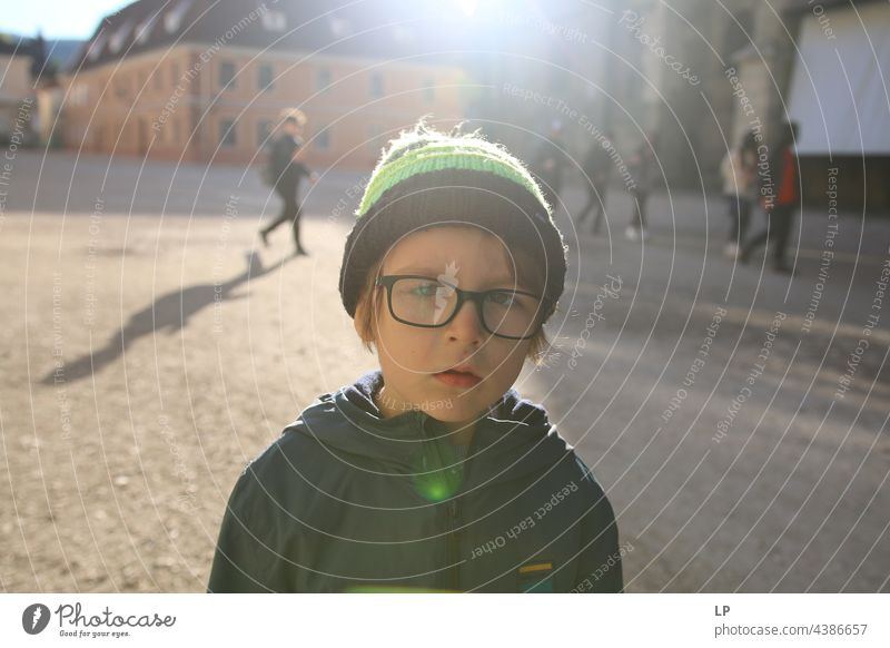 boy wearing a hat and glasses looking doubtful secret Contentment Mysterious youthful Uniqueness Change Identity Illusion naturally Gaze Conceited Beautiful