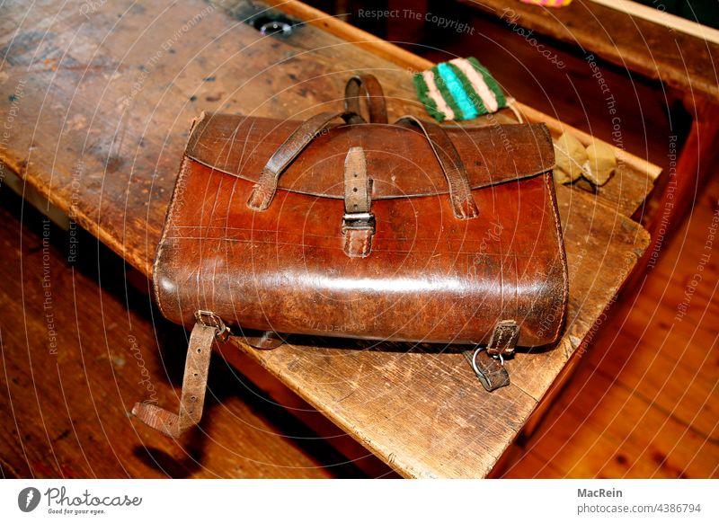 Old school desk from the 50s with satchel Satchel Table School desk Bag Inkpot Sponge Wooden table School bench vintage Brown nobody Copy Space then retro style