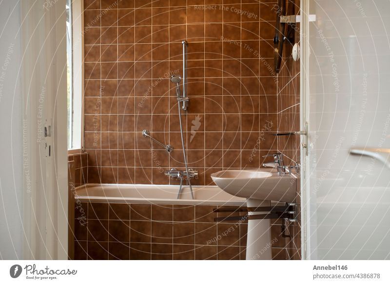 Architecture interior of a old vintage bathroom with brown tiles, Antique design, interior house concept hotel glass health indoors lamp light luxury mirror