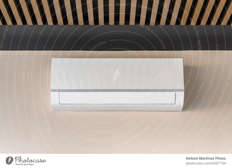 White air conditioner on beige wall cooler cold cooling heat ventilated temperature fan climate wind industry equipment isolated electronic wall-mounted blowing