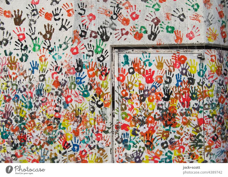 Hand for hand on wall Street art Imprint Many Teamwork Play of colours Creativity Agreed Abstract Silhouette Decoration Background picture