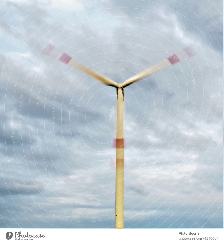 Wind turbine with rotating blades two disappearing in the clouds one parallel to the tower Pinwheel turning Grand piano Rotor blades Clouds Blue White windy