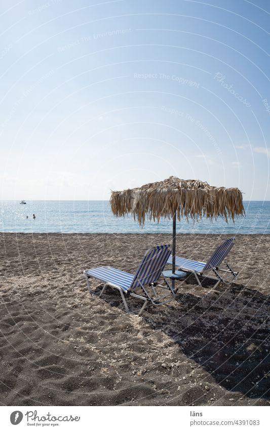 Holiday on the beach Beach Ocean Sand Water Greece Vacation & Travel Relaxation coast Horizon Sunshade Beach loungers Exterior shot Tourism Santorini
