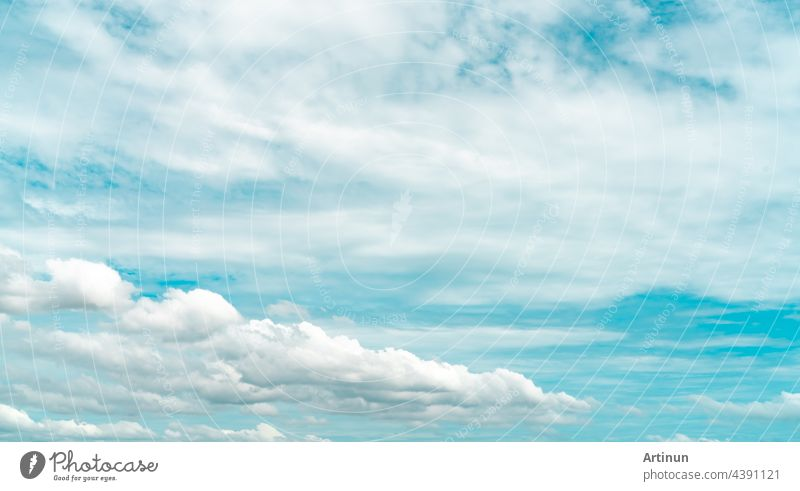 White fluffy clouds on blue sky. Soft touch feeling like cotton. White puffy cloudscape. Beauty in nature. White cumulus clouds texture background. Sky on sunny day. Pure white clouds. Beautiful sky.