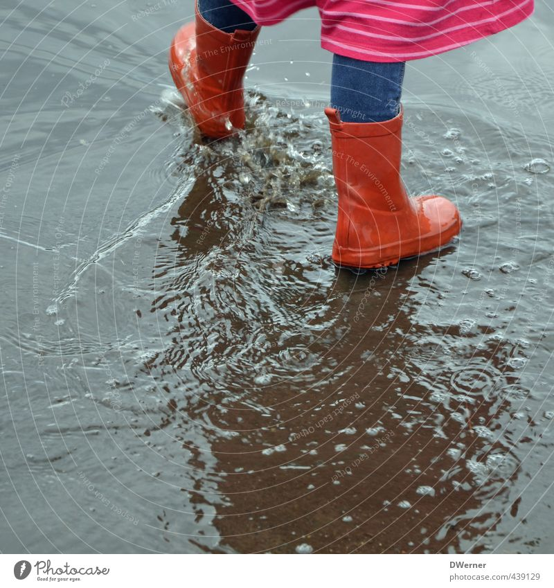 water features Happy Playing Aquatics Parenting Kindergarten Child Schoolchild Girl Legs Feet 1 Human being 3 - 8 years Infancy Bad weather Rain Street Dress