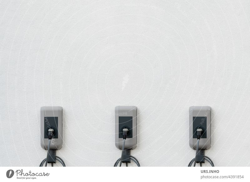 the charging stations on the house wall supply energy for three e-cars at the same time Loading dock Home charging station electromobility Minimalistic