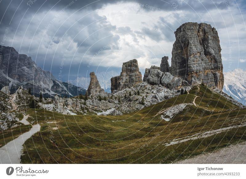 Hiking trail in Cinque Torri Dolomites on summer day. Italy dolomites cinque torri sky blue mountain landscape italy travel hiking nature peak rock alps europe