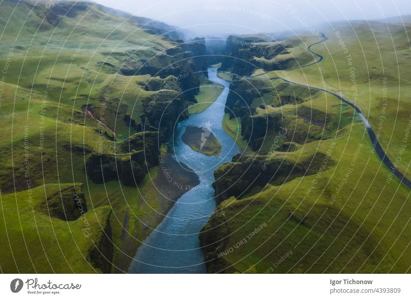 Aerial view of Fjadrargljufur Volcanic Canyon Iceland on moody overcast weather iceland aerial canyon fjadrargljufur drone volcanic landscape river nature