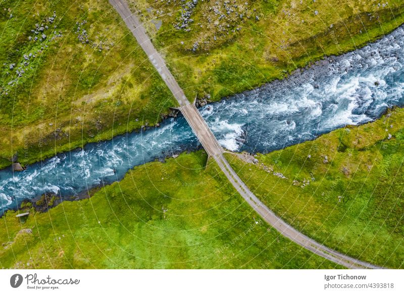 The aerial top down view of a milky blue river and a bridge, Iceland iceland remote rock scenery top view park tourism travel tree volcanic outdoor mountain