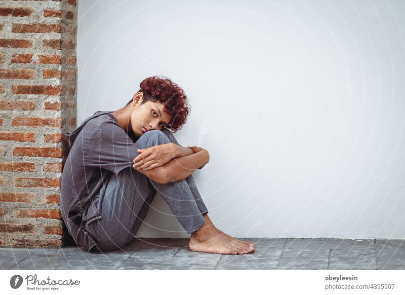 Boy stays home bored by school closings due to covid pandemic.sad and alone in the house young boy people person portrait cute expression unhappy sadness face