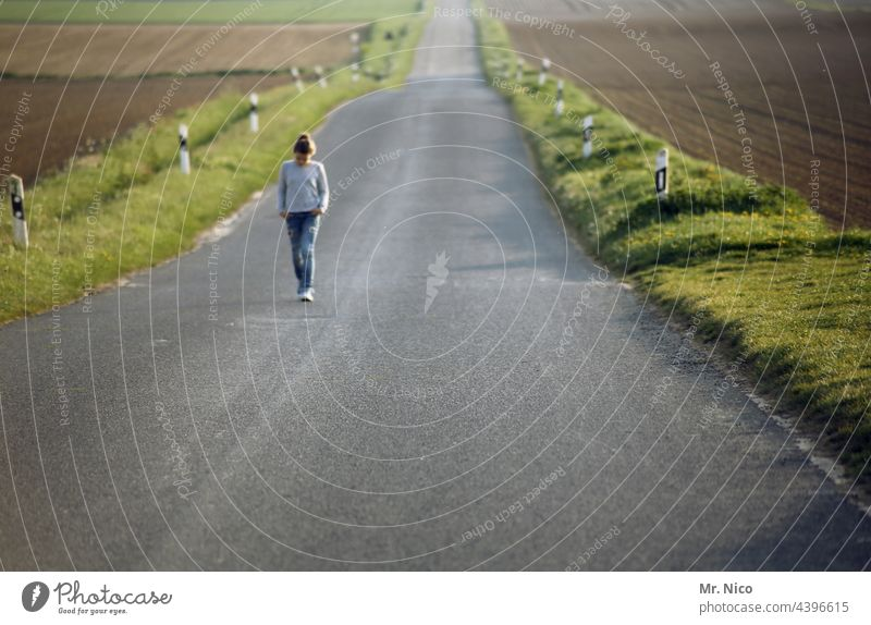 A long way back Lanes & trails Street Girl Freedom Far-off places Environment Field Right ahead Asphalt To go for a walk Going Single-minded Roadside In transit