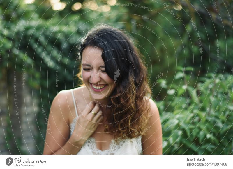 Woman - curls - beautiful 25-29 years Brunette pretty youthful Esthetic Summer Green eyes closed Curl Laughter Sincere Exterior shot Adults Colour photo