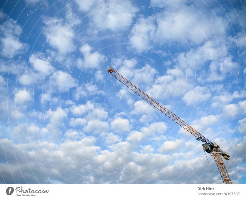View of a crane in front of a cloudy sky Crane Sky Clouds Construction crane Technology Construction machinery Construction site Build Work and employment