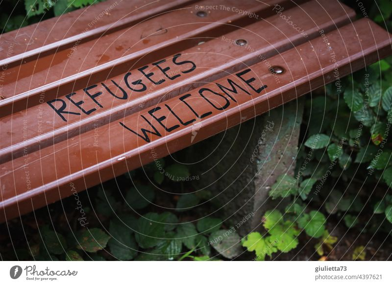 Refugees welcome   Lettering on a bench Graffiti Welcome writing Bench Park Exterior shot Characters Deserted Colour photo refugees welcome Hospitality