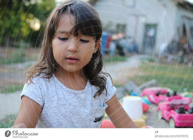face of a beautiful child looking  down Individual Isolated Single Abstract Flow Children's game Childhood memory candid dreamy singular Exceptional theology