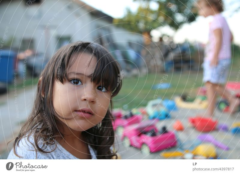 face of a beautiful child looking at the camera positive emotion Individual Isolated Single Abstract Flow Children's game Childhood memory candid dreamy