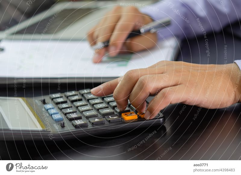 businessman hand pressing a calculator Business, finance, tax and investment concept. accounting financial calculate management money work accountant analysis