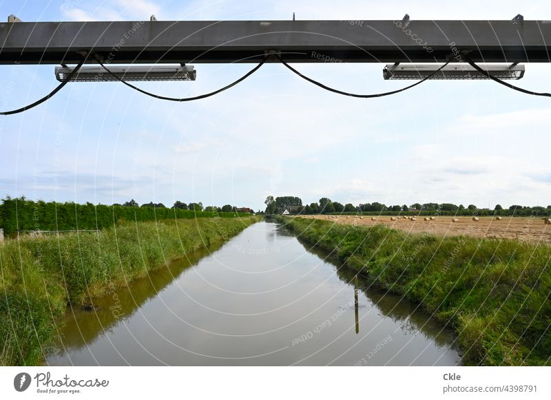 Flethwedder River Channel pumping station Dike fields meadows trees Water Old Dike march flood protection Cable Steel carrier Agriculture