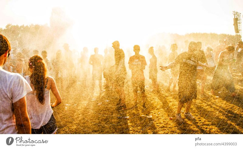 Sun, dust and festival. Sunlight Dance Dust Sand Water Joy Exterior shot Summer