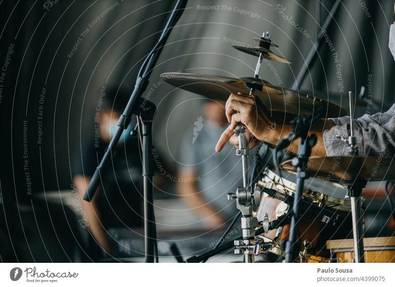 Close up man assembling drum set Drum Drum set Drummer Assembly assemble Music percussion drummer instrument Beat Rock music Musician Rhythm sticks