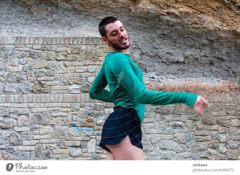 portrait of a dancer young gay happy lifestyle person man dancing pride background identity male lgbtq people performance joyful fashion young adult handsome