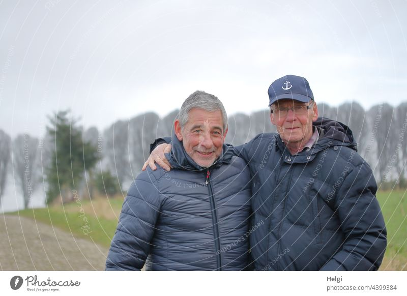 Friends - portrait of two friendly seniors in winter jackets outside in nature Human being Man Senior citizen Winter Jacket cap Gray-haired Facial hair