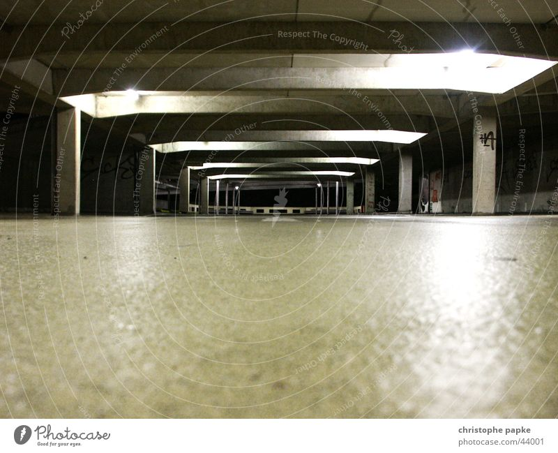 Total of a dark and empty parking garage Parking garage Underground garage conceit Garage Empty Trashy Deserted Fear Concrete Threat Architecture