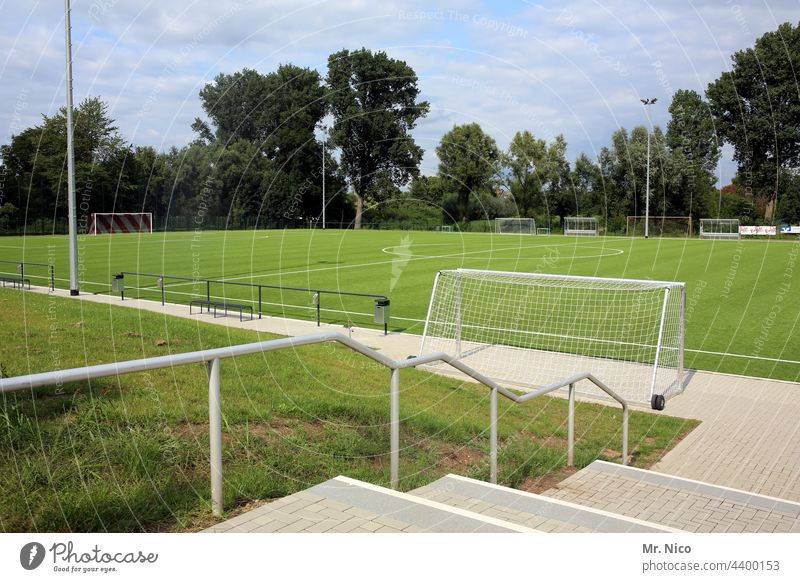 sports field Sporting grounds Sports Leisure and hobbies Playing field Football pitch Lawn Sporting event Sporting Complex Grass surface Green Stairs Banister