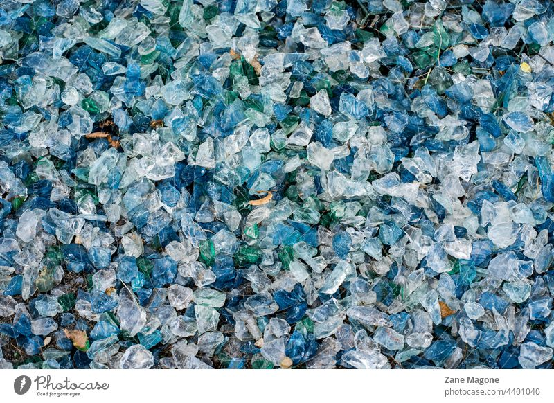 Background of blue and white glass stones texture pattern surface textured wall rock granite gray grey marble backgrounds floor macro nature material closeup