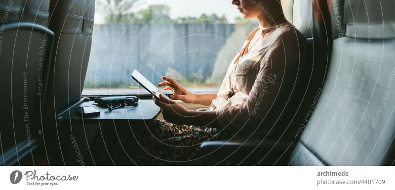 Woman traveling by train using mobile phone window work busy seat commuting commuter transportation woman unrecognizable glasses anonymous copy space technology