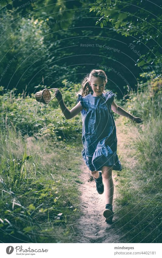 Girl with basket runs through the forest Child childhood Children's game Freedom Nature nature lovers Childhood memory Infancy Playing Joy Leisure and hobbies