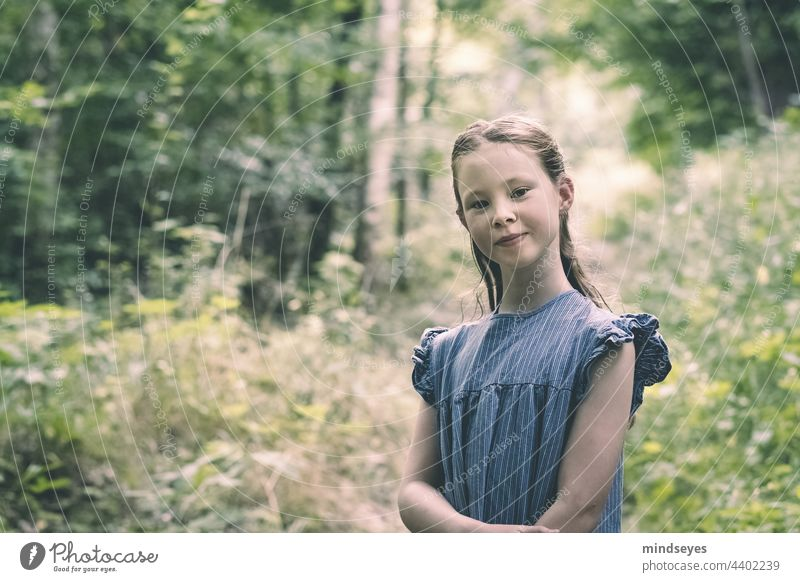Girl in the forest smiles into the camera Nature Forest Child Infancy Summer Playing Happiness Portrait photograph selbstbewußt Smiling childhood children