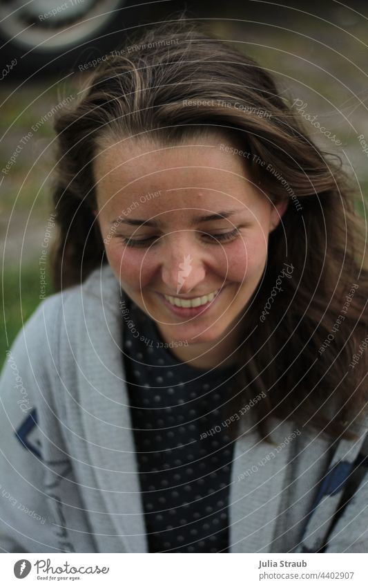 friendly laugh of a woman Attractive Self-confidence brown hair laughs Show your teeth feminine Joy Woman laughing Laughter hair in the wind open hair