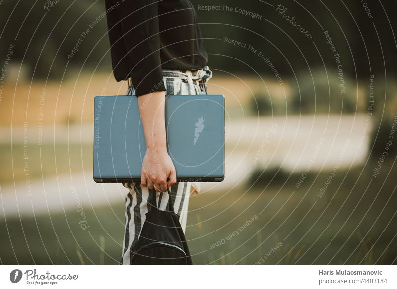 woman freelancer holding laptop outdoors in nature 5g concept connection developer digital digital nomad equipment explore freedom freelance concept glass